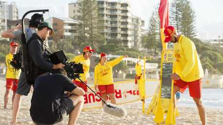 Film Crews working on a Surf Life Saving Queensland television commercial at Kings Beach, Caloundra. Picture: Lachie Millard