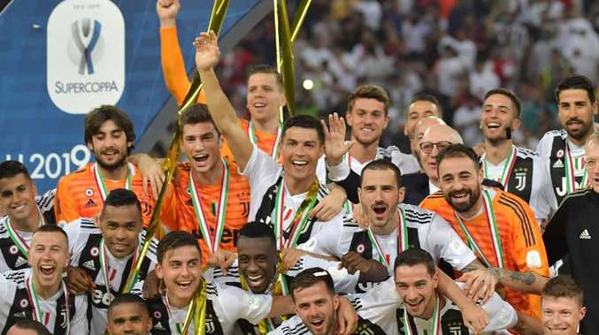 Juventus players celebrate their Supercoppa Italiana final win against AC Milan at the King Abdullah Sports City Stadium in Jeddah. Picture: AFP