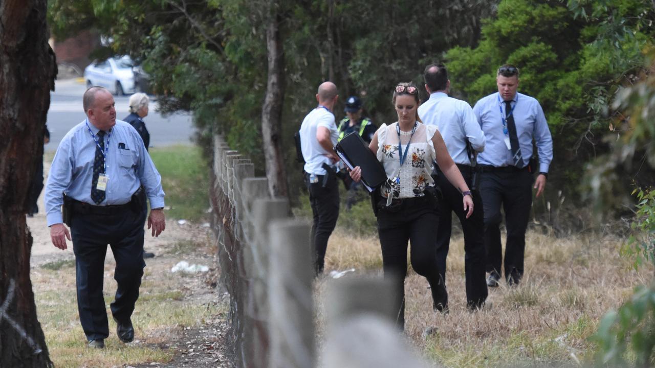 Police and SES crews in Bundoora Park. Picture: Tony Gough