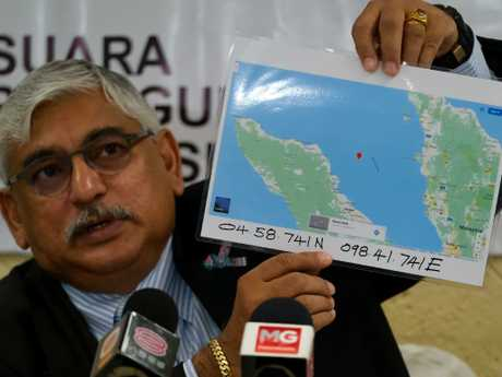 CASSA Malaysia president Dr Jacob George shows the co-ordinates and will hand the information to the Prime Minister. Picture: Mohd Samsul Mohd Said/Getty Images