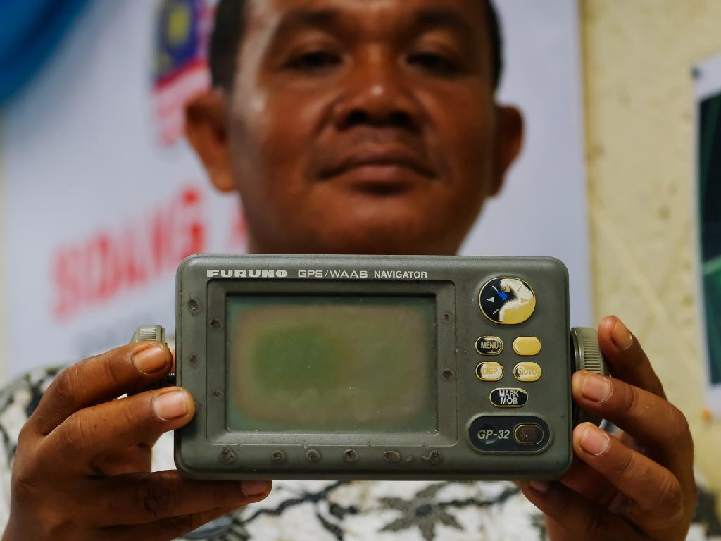 Rusli Khusmin, 42, a fisherman from Indonesia shows his GPS navigator which he used to record the co-ordinates of where he believes Malaysia Airlines Flight MH370 crashed. Picture: Mohd Samsul Mohd Said/Getty Images