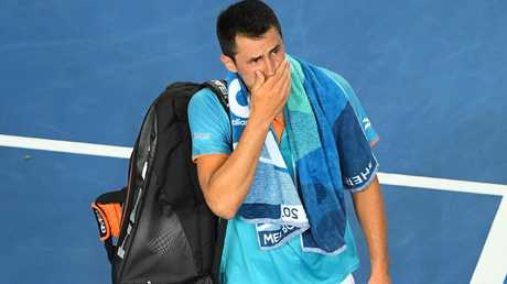Bernard Tomic leaves the court after his first round loss. Picture: Getty Images