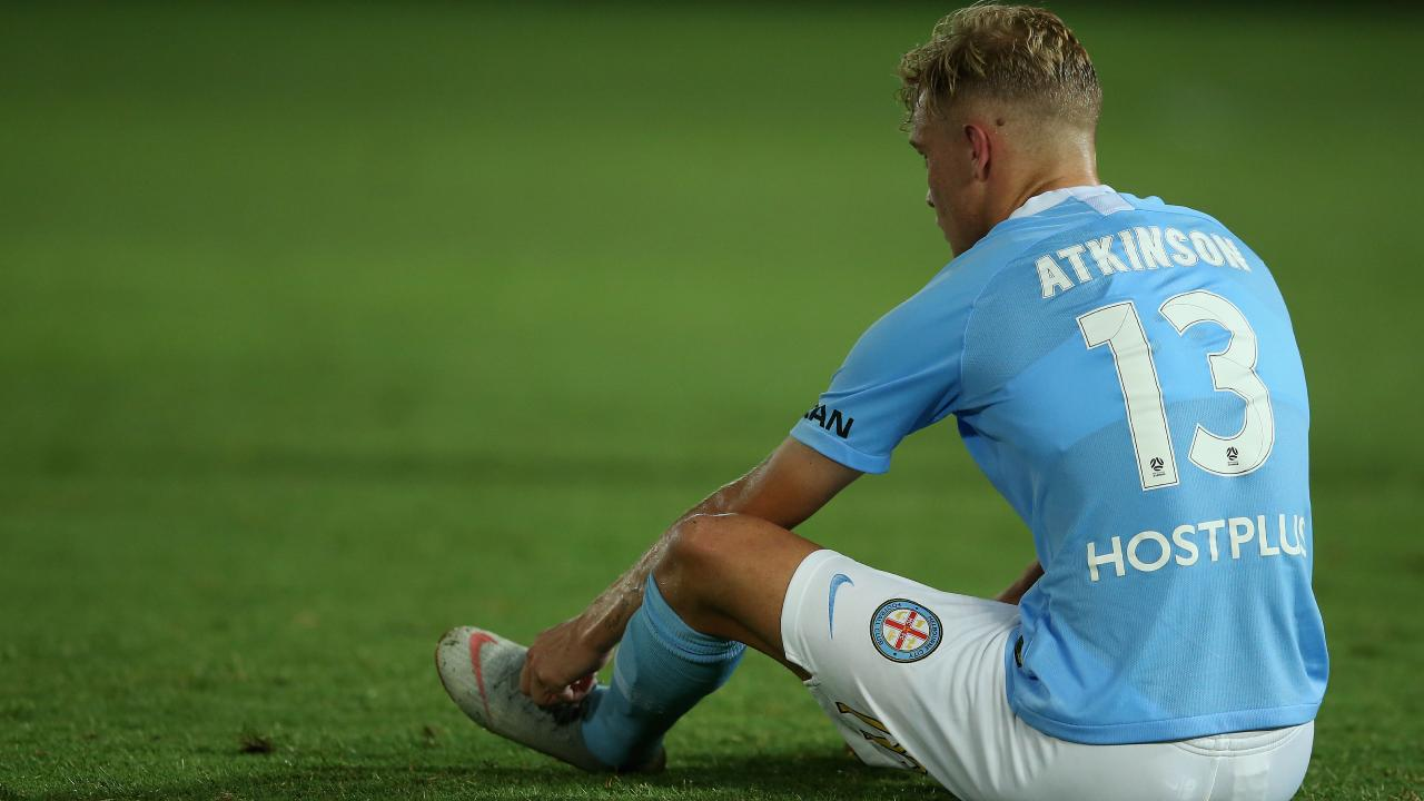 Melbourne City's Nathaniel Atkinson looks dejected after the shock loss to the Mariners last night. Picture: Getty Images