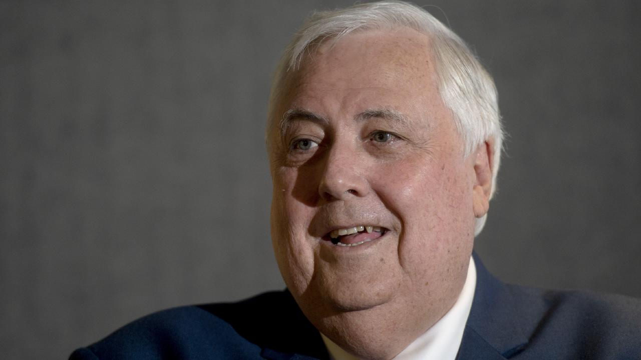 Clive Palmer has climbed the Aussie rich list despite owing millions.