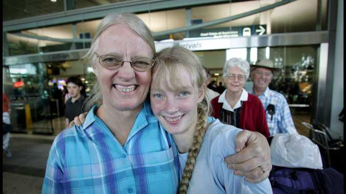 Gladys Staines with Esther arriving at Brisbane International Airport in 2004.