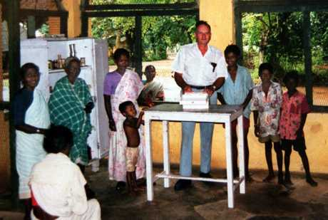 Australian missionary Graham Staines working with locals prior to being burnt to death with his two sons by anti-christian extremists in village in eastern State of Orissa, India