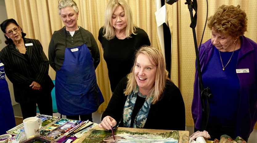 WOMEN'S WORK: Watercolour artist Cheryl Bruce leads one of the monthly Tuggerah Lakes Art Society workshops, with onlookers including president Rasheeda Flight, left, and Pam Brooks, right.