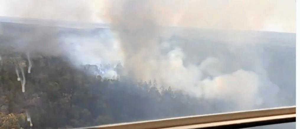 An aircraft monitors a fire burning near Inverell yesterday. There's a high fire danger today across much of Northern NSW.