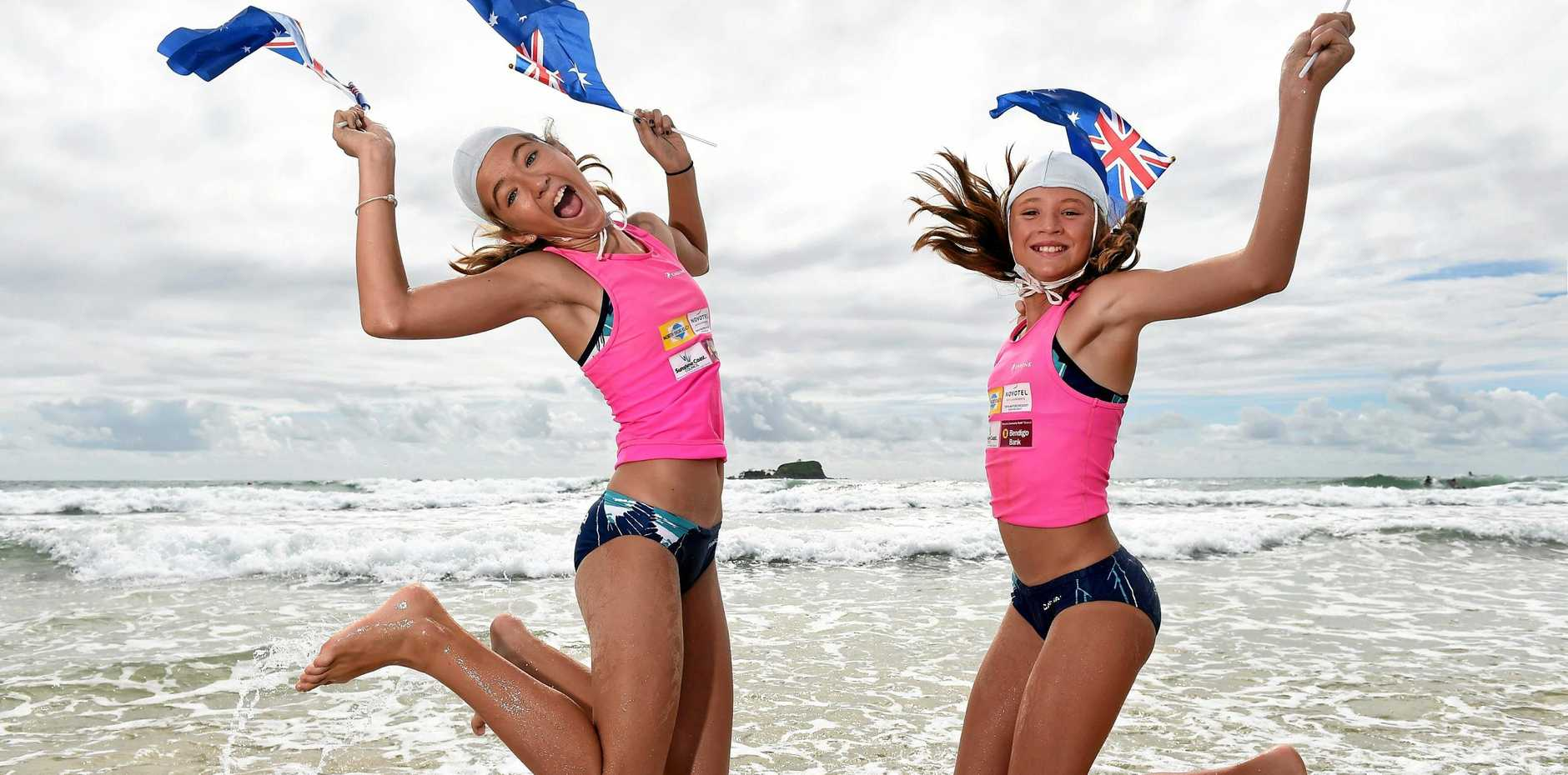MAKING MEMORIES: Daily photography Patrick Woods snapped Mudjimba Beach nippers Alexandra Hansen and Holly Adams getting ready for Australia Day celebrations.