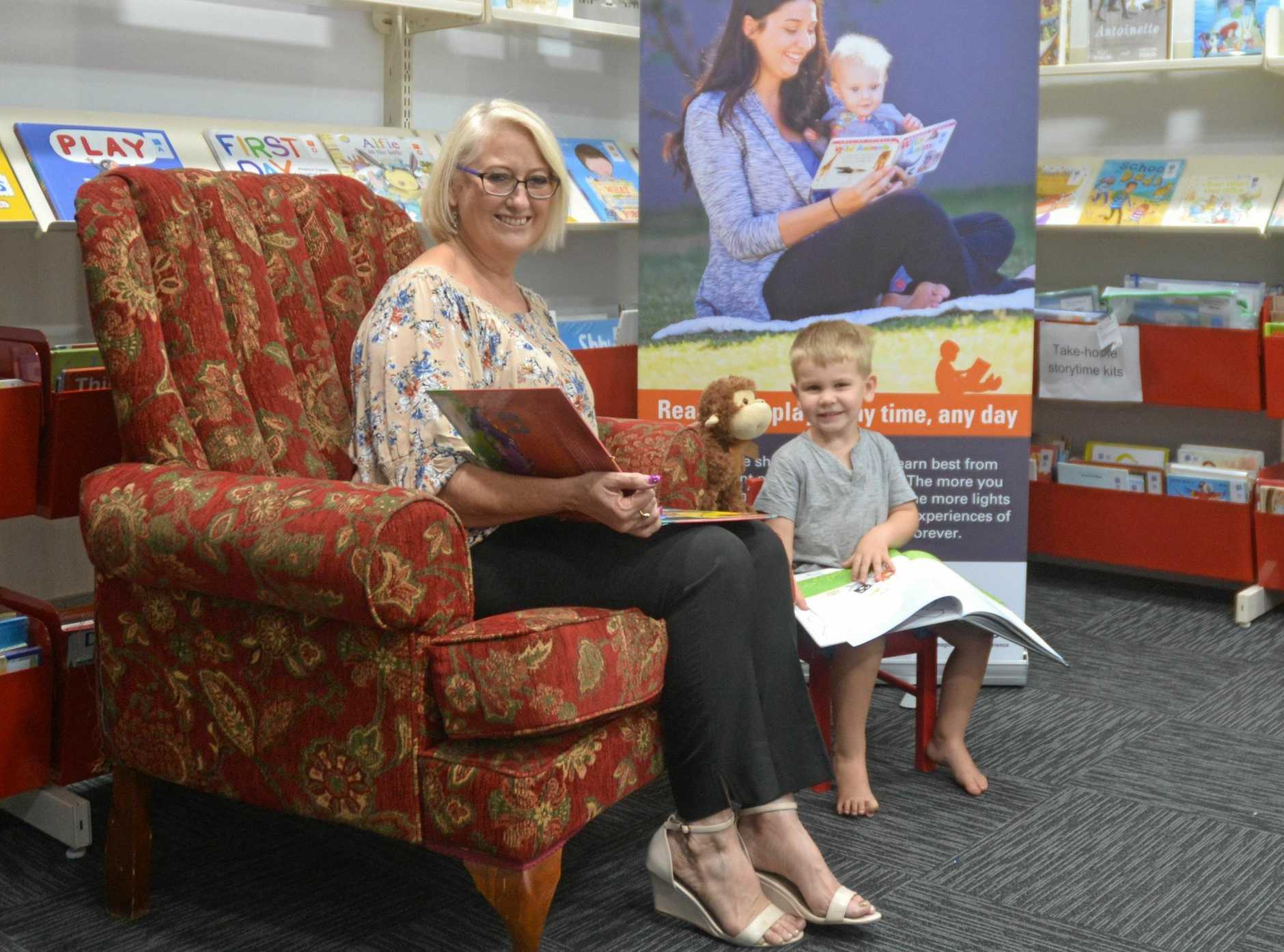 READY TO READ: Councillor Kaye Maguire reading with Zeke Rogers at the Chinchilla Library.