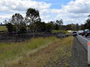 Car rolls and catches fire on Bruce Highway at Glenwood
