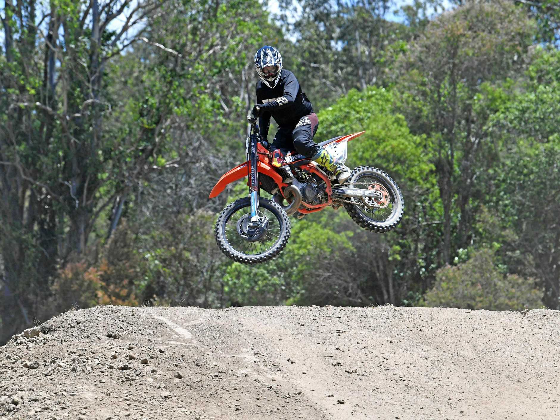 HOME TURF: Gympie motocross rider Jesse Bishop practices his move on the MX Farm Queensland track at Curra.