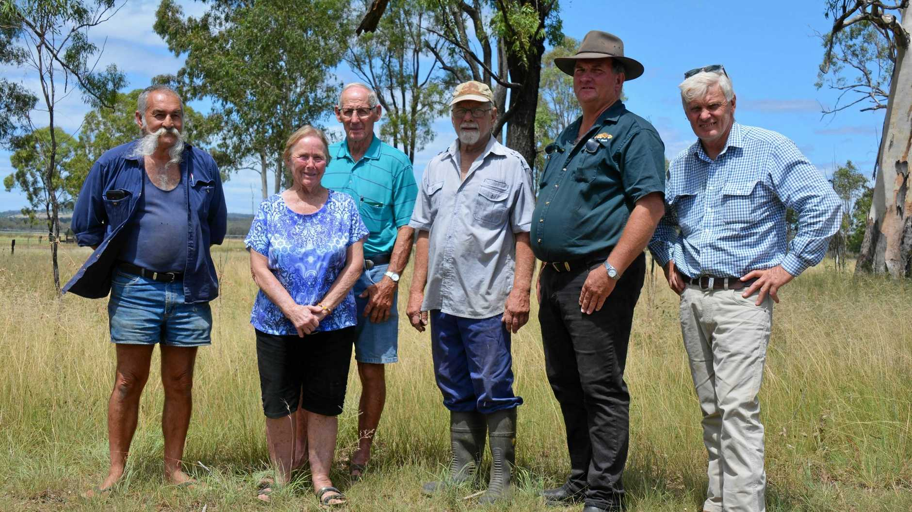 CONCERN: Danny Goodwin, Val and Col Elliott, Mark Hansen, Tony Oberle and Ian Newson who stand near the site of the old Mondure Railway station say a potential Proston rail trail would be a biosecurity risk.