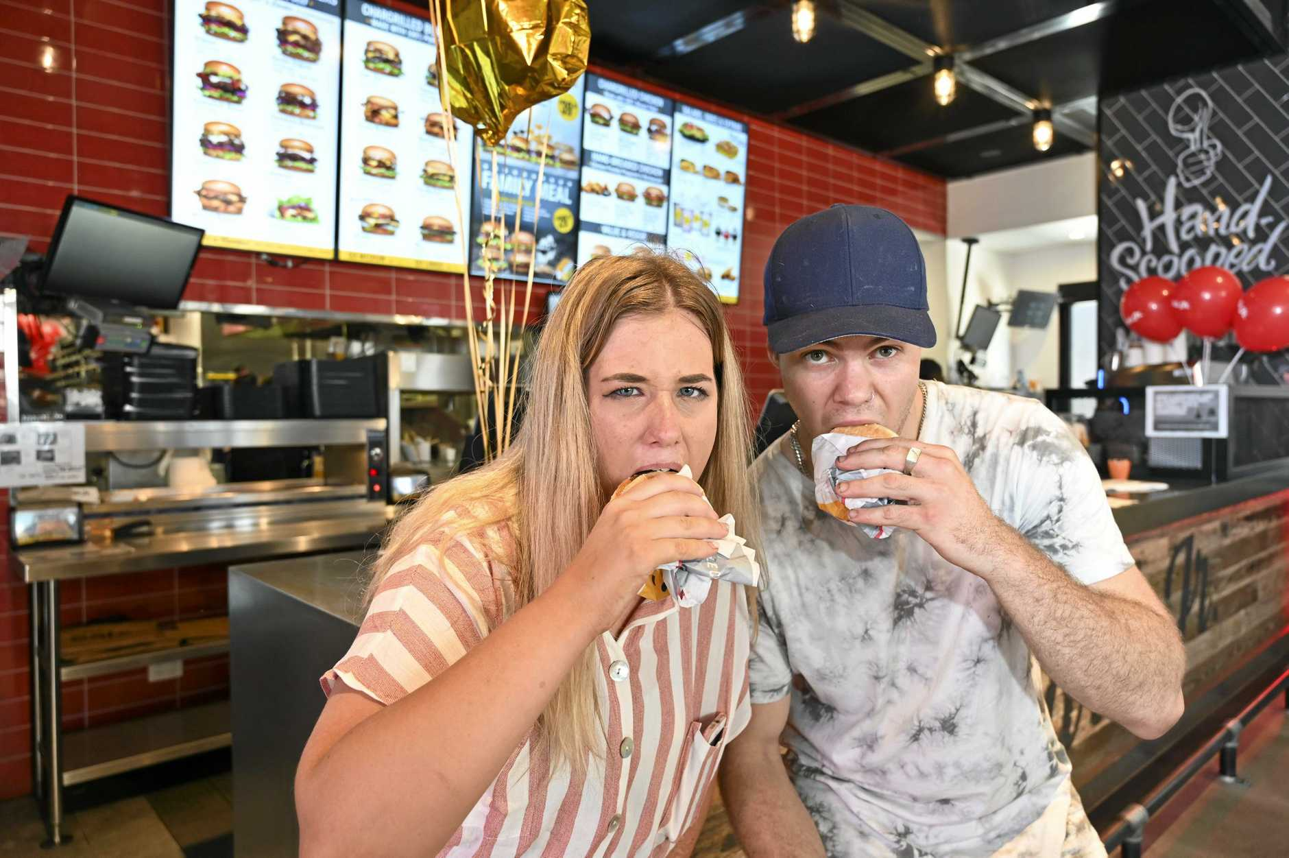 Carl's Jr. Redbank Plains first birthday. Michayla Rickard from Springfield Lakes with Kerryn Samanobic from Collingwood park with their free cheeseburgers.