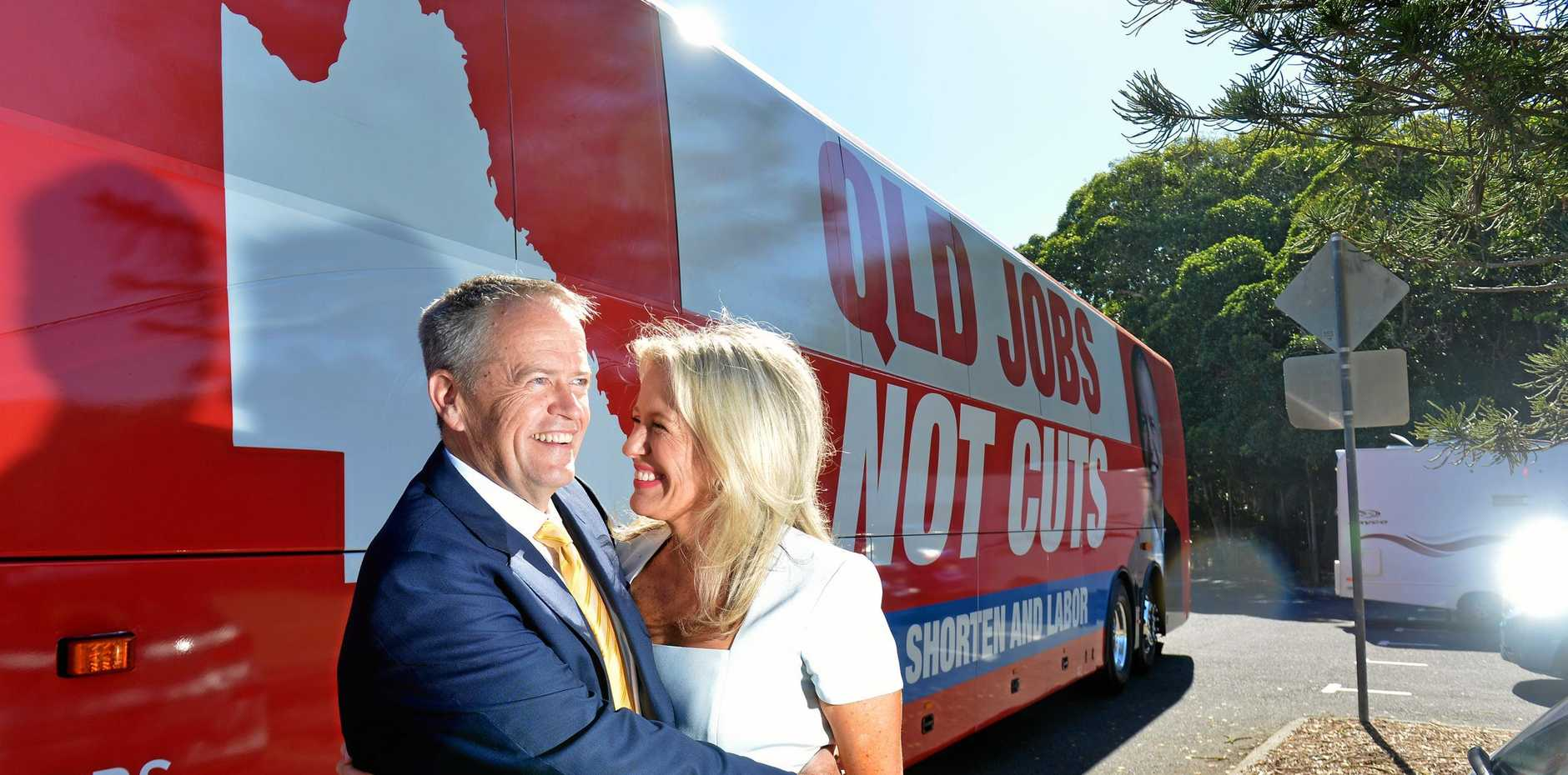 Federal Opposition leader Bill Shorten and his wife Chloe arrive at Moffat Beach in a big red bus on their first day of holidays on the  Sunshine Coast.