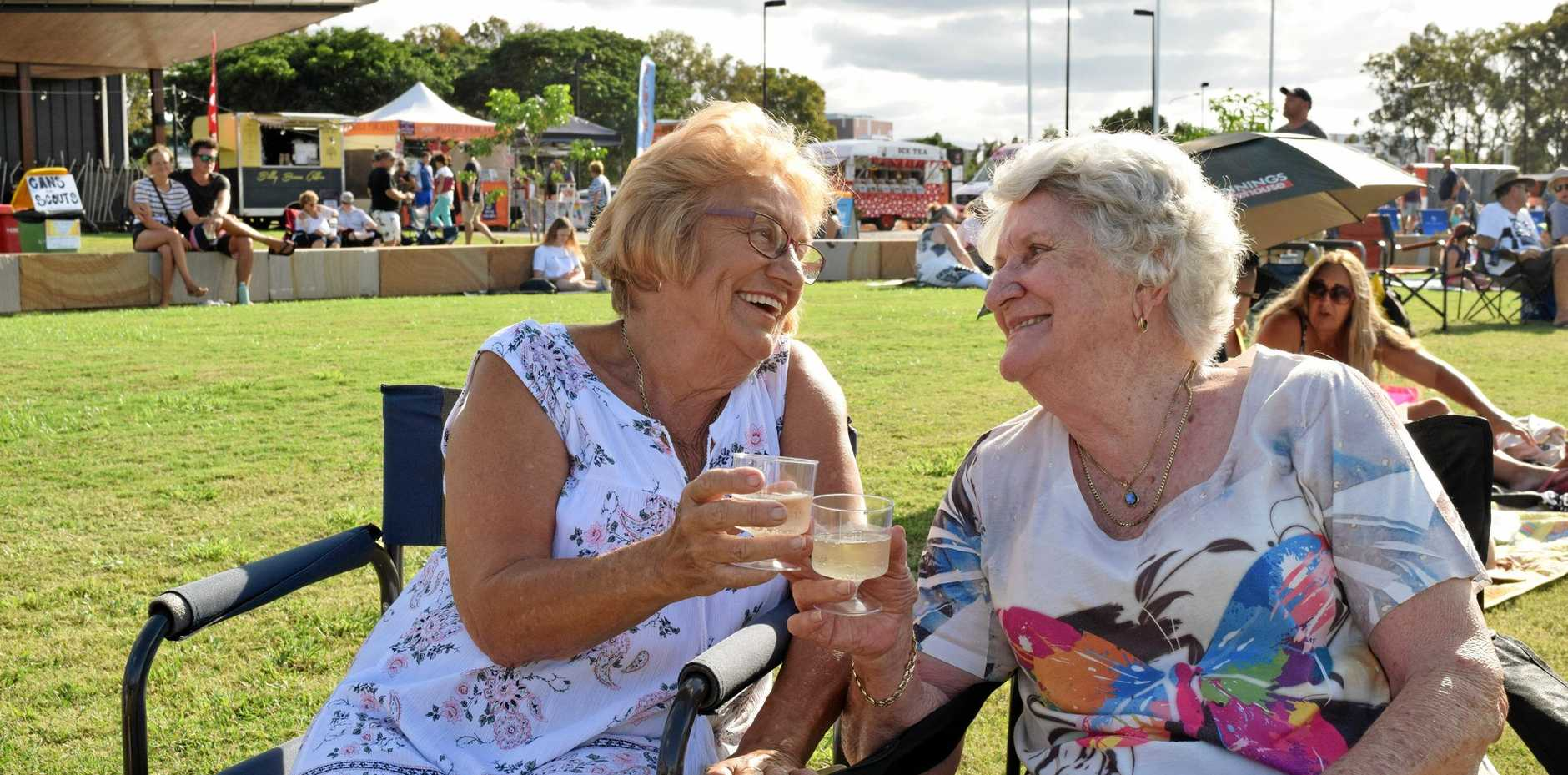 BUBBLES AND BLISS: Hervey Bay locals Pauline Derich and Margaret Porter enjoy the live entertainment at Food 'n' Groove Fridays at the Pialba City Park yesterday.