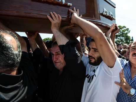 Mourners carried the coffin of Alfredo Isho. Picture: Monique Harmer.