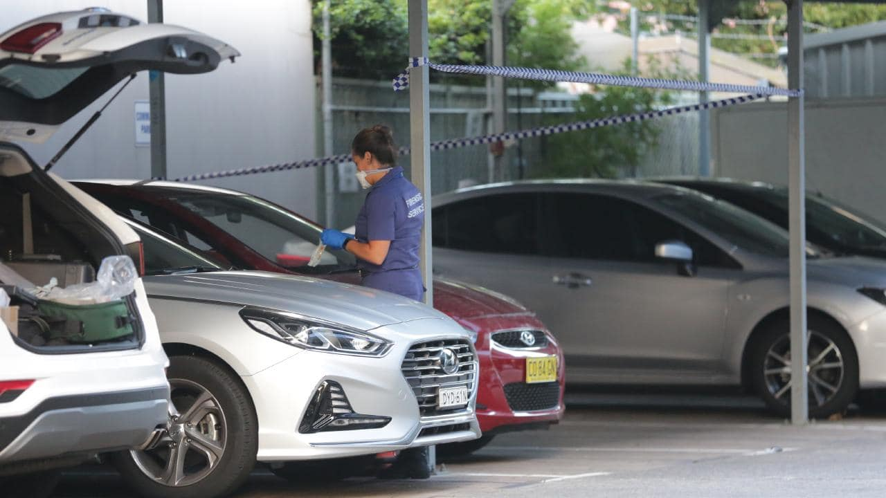 Police inspect the car at Mascot police station. Picture: Christian Gilles