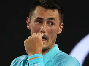What threats? Tomic responds to 'liar' Hewitt