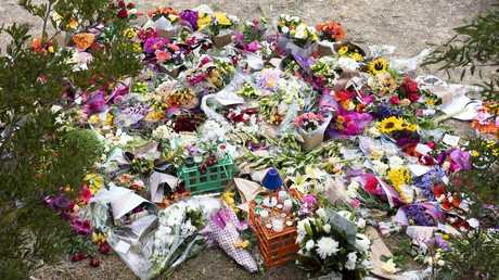Floral tributes for Aiia near the Polaris Shopping Centre. Picture: AAP