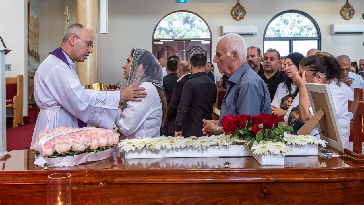 Mourners gathered at the funeral of Alfredo Isho. Picture: Monique Harmer.