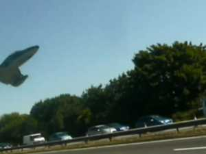 Shocking moment plane slams into traffic