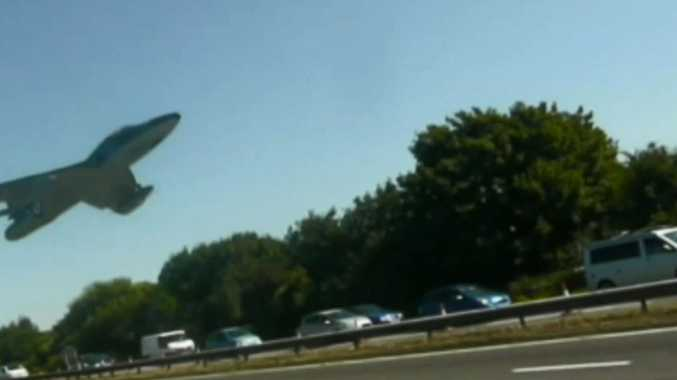 The doomed jet a second before it crashed onto motorist and air show spectators on the A27 road outside Brighton.