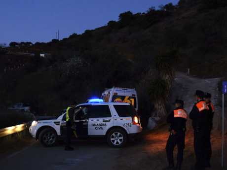 Emergency services at the scene where a toddler fell down a well. Picture: AP