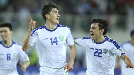 Uzbekistan's Eldor Shomurodov celebrates after scoring the opening goal against Japan at Khalifa bin Zayed Stadium in Al Ain. Picture: Kamran Jebreili