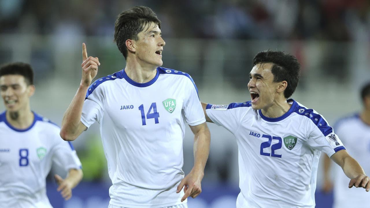 Uzbekistan's Eldor Shomurodov celebrates after scoring the opening goal against Japan at Khalifa bin Zayed Stadium in Al Ain. Picture: Kamran Jebreili