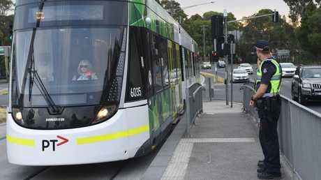 Police man tram stop on Plenty Road, Bundoora. Picture: Tony Gough
