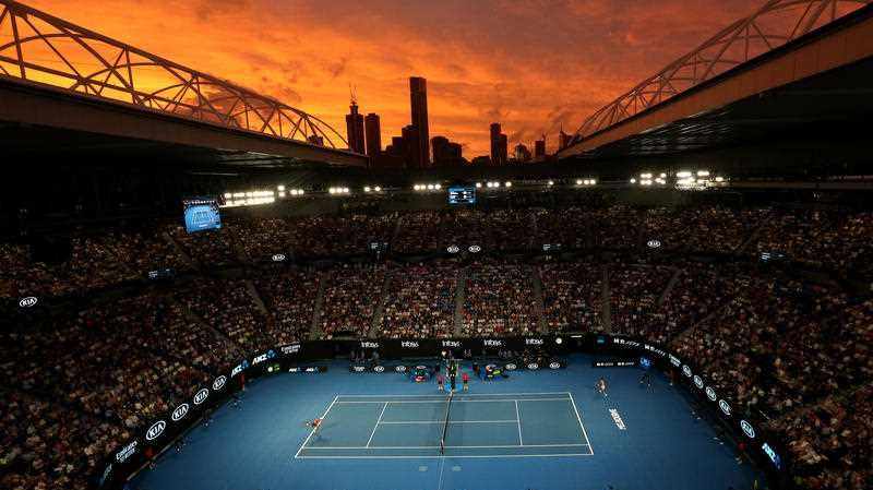 The sky is seen at sunset over Rod Laver Arena during the match between Rafael Nadal of Spain and Alex de Minaur of Australia during day five of the Australian Open tennis tournament in Melbourne, Friday, January 18, 2019.