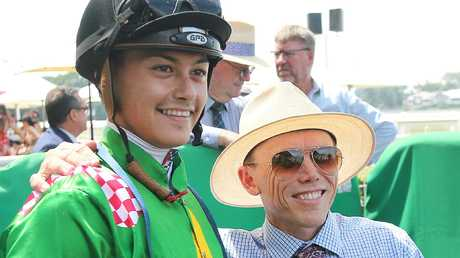 Jockey Michael Murphy and trainer Chris Munce celebrate Snoopy's drought-breaking win. Picture: AAP