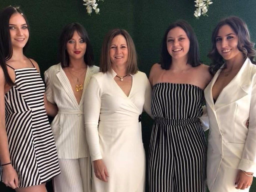 Natalie Joyce (centre) with daughters Odette, 16, Bridgette, 21, Caroline, 19, and Julia, 20.