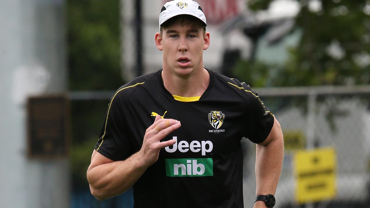 Tom Lynch runs laps at Richmond training. Picture: Michael Klein