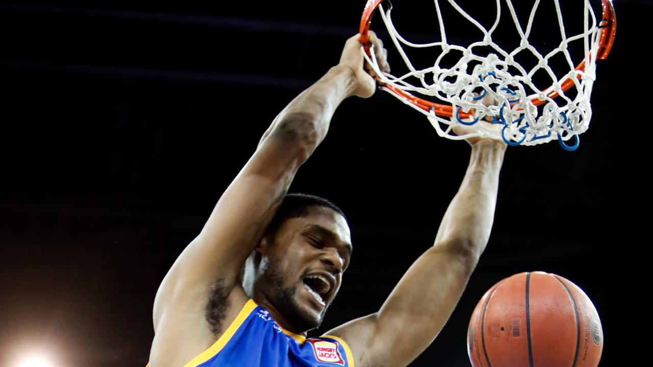 AJ Davis of the Bullets dunks the ball against Cairns on Saturday night. Picture: AAP