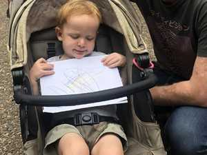 Toddler's cheeky sign targets stupidity