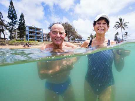 Retired Plumber Markus Widmer, 81, and wife Jannette, 83, who is a retired rurse, enjoy their daily ritual of a morning swim at Bargara. Picture: Lachie Millard