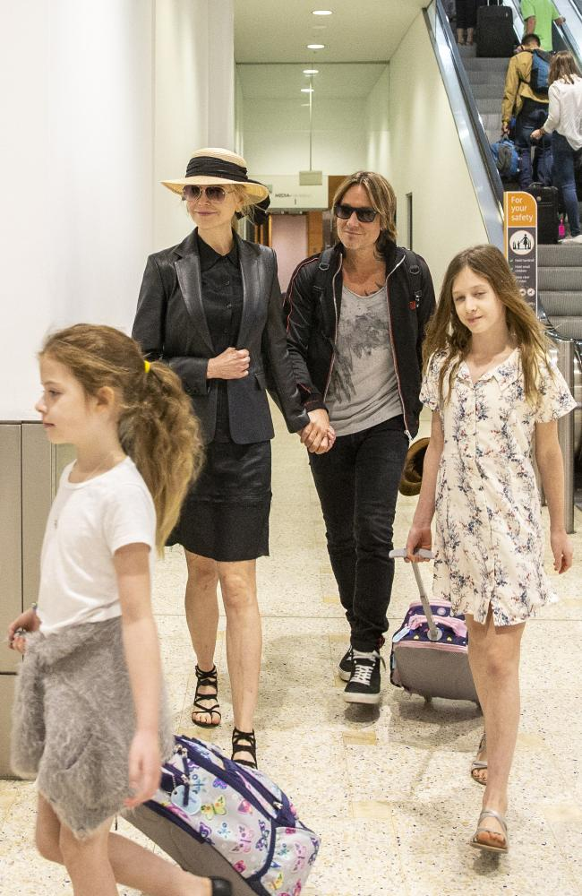 Nicole Kidman, Keith Urban and their children arrive at Sydney International Airport before Christmas. Picture Jenny Evans
