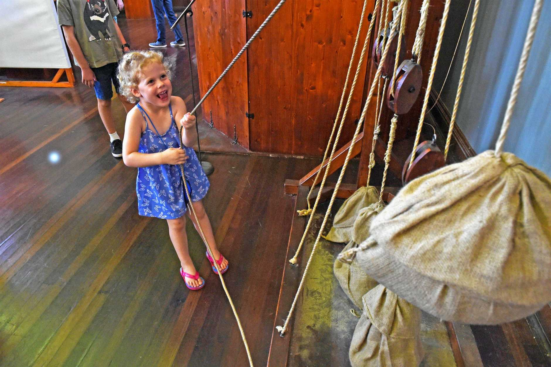 IN THE MIND OF A GENUIS: Charlotte Bishop, 4, discovering the pulley system at the Da Vinci Machines exhibit. The travelling exhibit was stationed in Maryborough until yesterday.