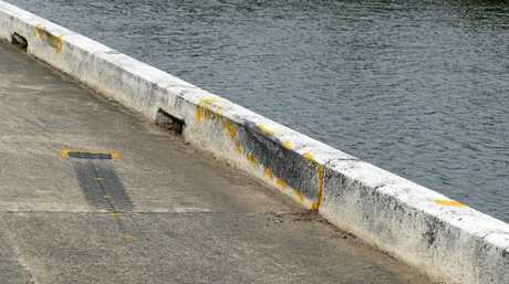 Tyre marks on the edge of the bridge where it appears the vehicle has gone over into the river.