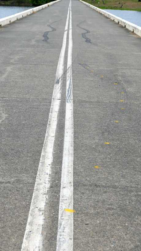 Spray painted yellow dots show investigators the path of the skid marks when the vehicle first braked.