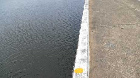 The final point marked on the bridge above the point where the vehicle most likely entered the water.