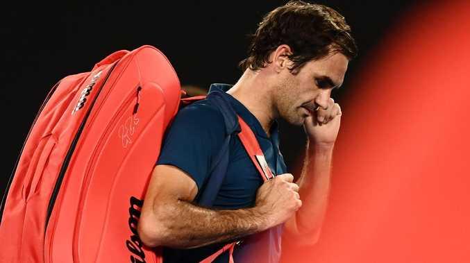 Roger Federer leaves Rod Laver Arena. Picture: AFP Photo