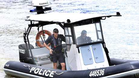 Police search the Brisbane River near Lower River Terrace. Picture: AAP/Richard Waugh