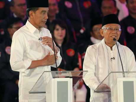 Indonesian President Joko Widodo listens as running mate Ma'ruf Amin delivers a speech during a televised debate in Jakarta. Picture: AP