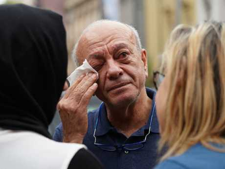 Aiia Maasarwe's father Saeed Maasarwe wipes away a tear at the vigil for his daughter in Melbourne. Picture: Stefan Postles.