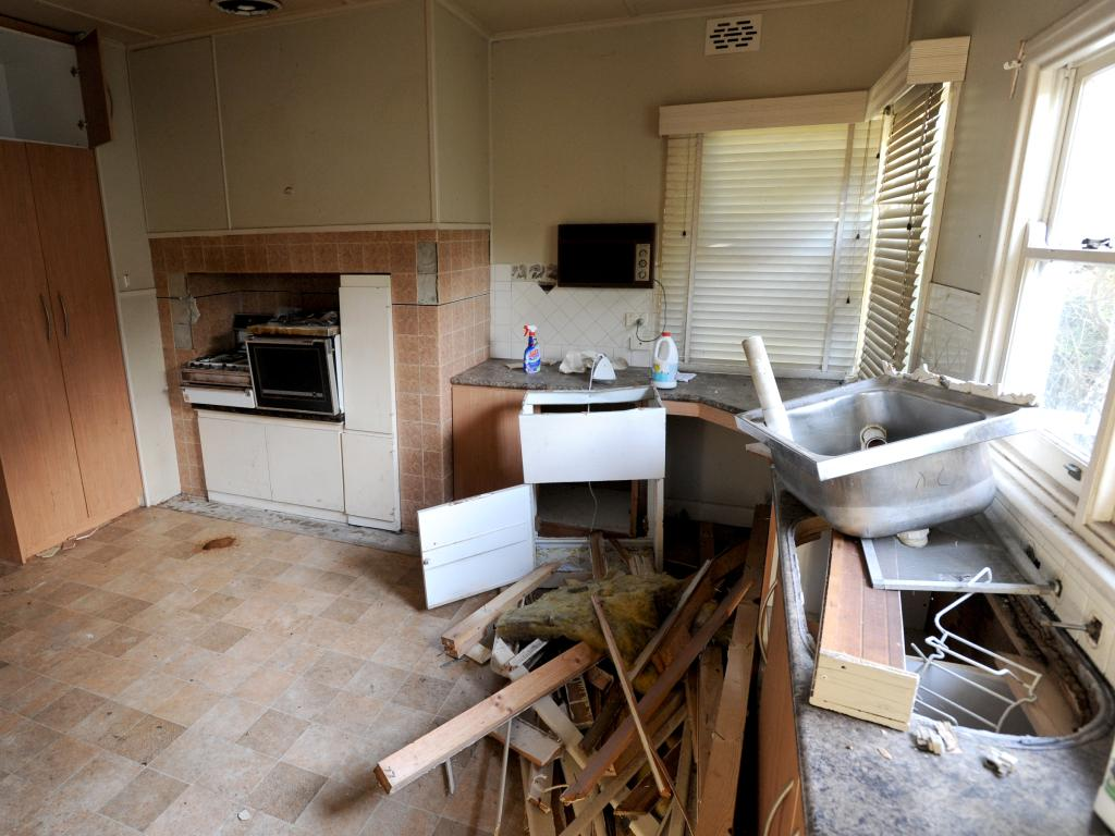 The trashed kitchen at the derelict squat house at Bundoora which is Codey Herrmann last known address. Picture: Andrew Henshaw.