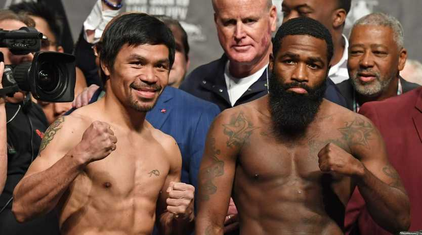 Always-smiling welterweight champion Manny Pacquiao and Adrien Broner pose during their official weigh-in at MGM Grand Garden Arena. Ethan Miller/Getty Images/AFP