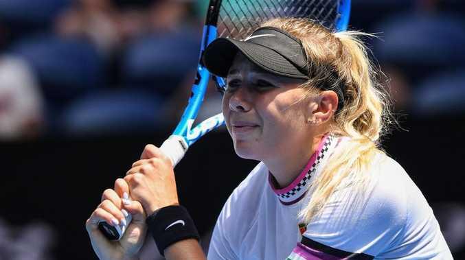 Amanda Anisimova of the US reacts after a point against Czech Republic's Petra Kvitova.